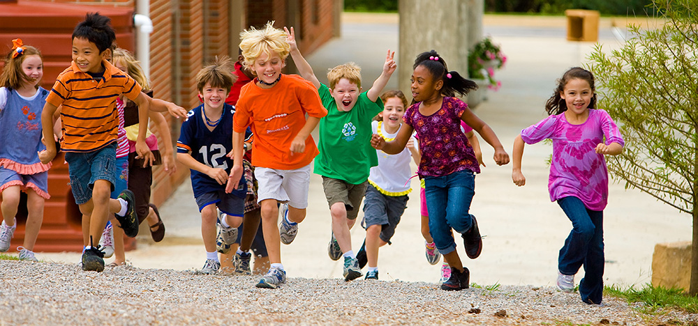 Children running towards playground